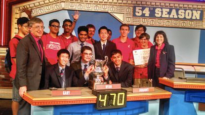 """Centennial High School's """"It's Academic"""" team celebrates a regional victory to cap off its championship season in at WRC-TV Channel 4 in 2015. Front row from left: Eric Seifter, Gary Tse, Ryan Heslin (captain), Anant Mishra and Sara Seifter. Back row from left: Richard Cui, Fayyaz Zaidi, Rohan Laljani, alternate Mohammed Khader, Lucas Cunningham, alternate Weijia Cheng, Nandan Dayal, Kevin Costello, William He and Jakob Boeye. (Handout/Baltimore Sun)."""