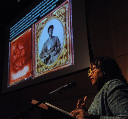 """Deborah Willis, professor at New York University, gives a lecture using photographs from a book she co-authored, """"Envisioning Emancipation: Black Americans and the End of Slavery."""""""