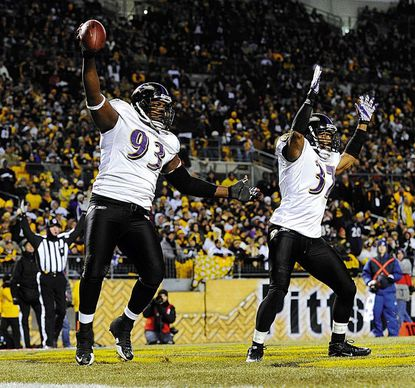 Cory Redding and Josh Wilson celebrate Redding's touchdown in the first half of the Ravens' AFC Divisional playoff game in Pittsburgh Saturday, Jan. 15, 2011.