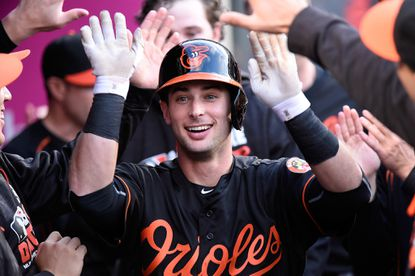 Orioles outfielder Joey Rickard returns to the dugout after hitting a home run in the first inning against the Los Angeles Angels of Anaheim at Angel Stadium of Anaheim on May 20, 2016 in Anaheim, Calif.