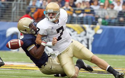 Navy linebacker Corey Johnson forces Notre Dame quarterback Jimmy Clausen to fumble during the 2008 meeting between the schools at M&T Bank Stadium. The stadium will host the Navy-Notre Dame football rivalry in 2022, it was announced Monday morning.
