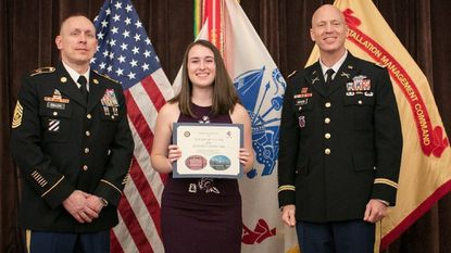 Katelyn Shibilski won the Youth Volunteer of the Year Award, with Garrison CSM Brian Cullen, left, and Garrison Commander COL Thomas Rickard, right. The 2018 Fort Meade Volunteer Awards Banquet was held at Club Meade April 26.