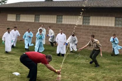 Scouts react as Chemistry merit badge counselor Ken Collins causes a stream of soda to spurt skyward, upon mixing Mentos with Diet Coke for a demonstration Saturday during the annual STEM in Scouting event at Aberdeen Proving Ground.