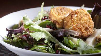 The fried goat cheese salad is a new item on the menu. In addition to the cheese, it features pears, dried cranberries and walnuts.