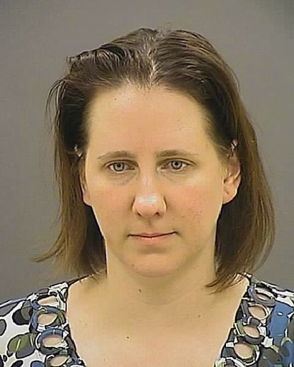 Lynette Trotta has been charged with having sex with a student at Archbishop Curley High School.