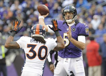 Joe Flacco throws under pressure from Broncos safety David Bruton in the Ravens' Dec. 16, 2012 loss to the Denver Broncos in Baltimore.