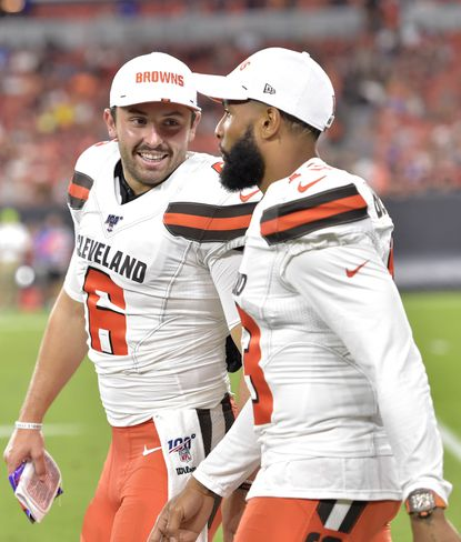 Cleveland Browns quarterback Baker Mayfield, left, smiles as he talks with wide receiver Odell Beckham Jr. during the second half of an NFL preseason football game against the Washington Redskins, Thursday, Aug. 8, 2019, in Cleveland. (AP Photo/David Richard)