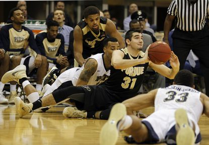 Dakota Mathias (31) of the Purdue Boilermakers makes a pass from the floor against the Pittsburgh Panthers at Petersen Events Center on Dec. 1, 2015 in Pittsburgh, Pa.