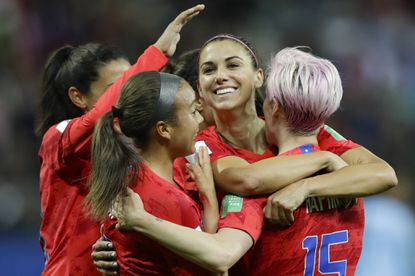 United States' Alex Morgan, second right, celebrates after scoring her side's 12th goal during the Women's World Cup Group F soccer match Tuesday between the United States and Thailand in Reims, France. Morgan scored five goals. (AP Photo/Alessandra Tarantino)