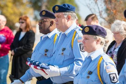 From right, Laurel American Legion Post 60 members Vicki Kunde, Kirk Birdsong and Rickey Witcher, at last year's Veterans Day memorial ceremony at Ivy Hill Cemetery.