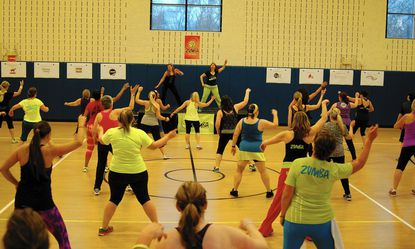 Logan Smith, left, and Tracy Cox lead participants during the two-hour Zumbathon at South Carroll Senior and Community Center, in Eldersburg, Jan. 25, 2015._- Original Credit: Kevin LeDoux/submitted photo