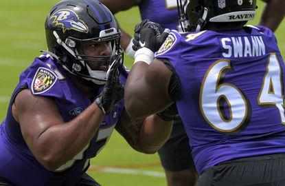 Baltimore Ravens defensive tackle Aaron Crawford practices with defensive tackle Jovan Swann (64) during OTA's Tue., June 8, 2021. (Karl Merton Ferron/Baltimore Sun Staff)