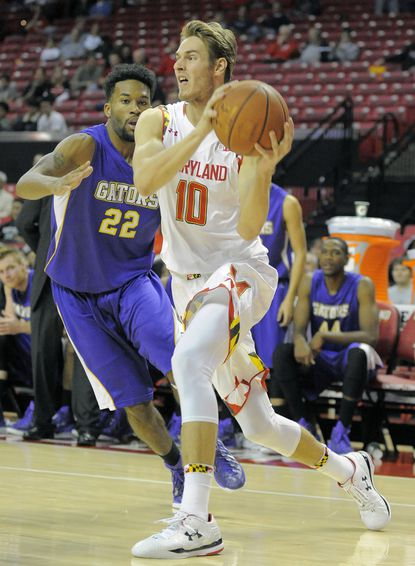 Maryland wing Jake Layman passes San Francisco State forward Derrick Brown and looks for an open man at Xfinity Center.