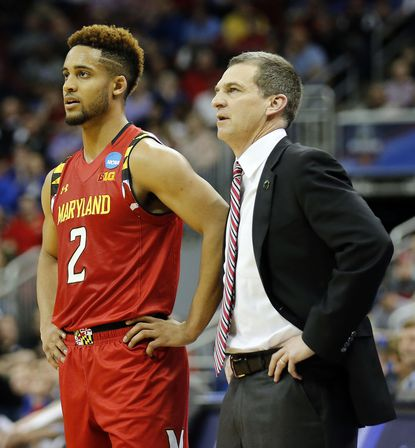 Maryland coach Mark Turgeon with Melo Trimble during the first half against Kansas during a Sweet 16 matchup in the NCAA Tournament's South region at the KFC Yum! Center in Louisville, Ky., on Thursday, March 24, 2016.
