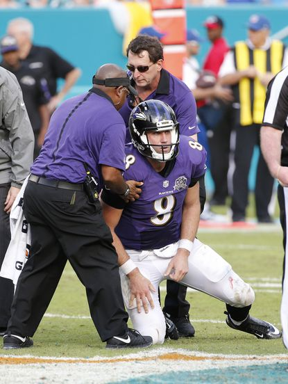 Baltimore Ravens personnel assist Baltimore Ravens quarterback Matt Schaub (8) up from the field during the second half of an NFL football game against the Miami Dolphins, Sunday, Dec. 6, 2015, in Miami Gardens, Fla.