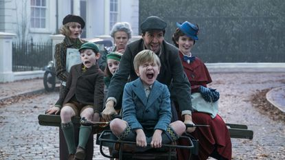 "Emily Mortimer, left, Nathanael Saleh, Pixie Davies, Julie Walters, Lin-Manuel Miranda, Joel Dawson and Emily Blunt in ""Mary Poppins Returns."""