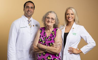 Helen Roby with Dr. Elizabeth Dovec and Dr. Gustavo Bello. Roby has lost 165 pounds with a combination of  bariatric surgery and healthy lifestyle choices.