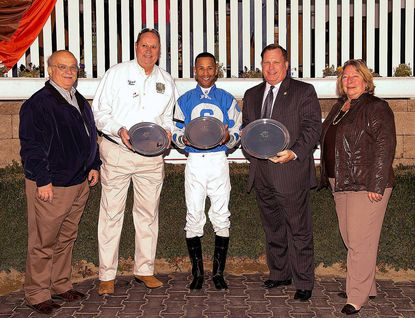 Joining jockey Kendrick Carmouche in the winner's circle after the City of Laurel Stakes at Laurel Park Nov. 9 are, from left, City Council members Mike Leszcz and Ed Ricks, Laurel Mayor Craig Moe and City Council member Donna Crary.