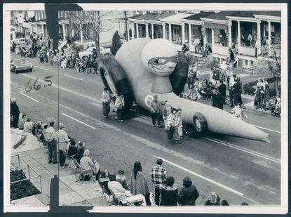 From 1973: A giant inflatable race car takes to the streets of Hampden during the first Mayor's Christmas Parade.