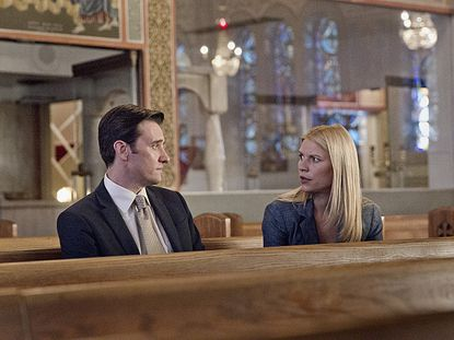 "Jason Butler Harner as Paul Franklin and Claire Danes as Carrie Mathison in ""Homeland."""