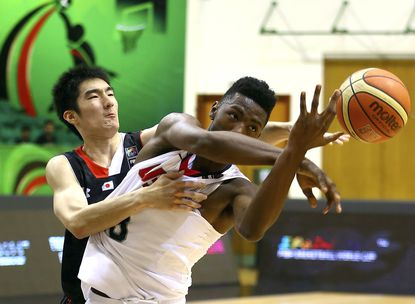 Harry Giles (right) competes for the ball with Gen Hiraiwa of Japan during the FIBA U17 world championships this summer in Dubai.