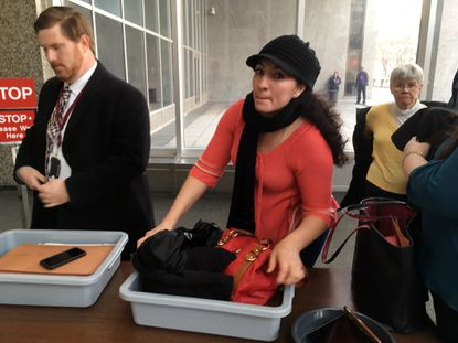 Roxana Orellana Santos heads into the U.S. Immigration and Customs Enforcement offices in downtown Baltimore in 2017. A federal judge granted a temporary restraining order against ICE in her case Monday.