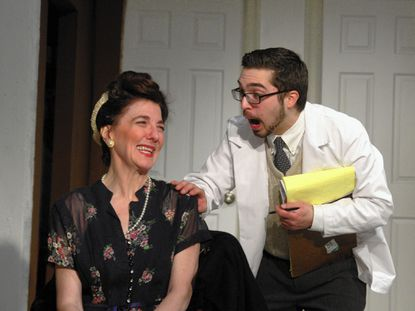 "Margaret Condo as Veta Louise Simmons and James Raymond as Dr. Saunderson in Laurel Mill Playhouse's production of ""Harvey."""
