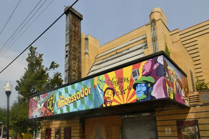 The Ambassador theater marquee has a new wrap-around art banner to signal its rebirth as a cultural hub in the Liberty Heights corridor. Artspace, the non-profit arts organization leading the redevelopment, worked with Creative Nomads, an arts group that collaborated with students at Calvin Rodwell Elementary School and Forest Park High School to create the artwork.