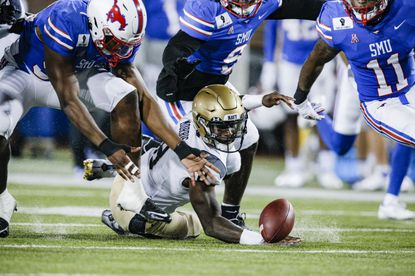Navy quarterback Dalen Morris (8), seen looking for the loose football in the first half against SMU on Saturday, has started the last four games but is battling to keep his starting job.