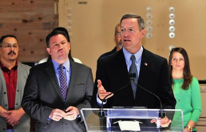 Gov. Martin O'Malley, with Howard County Executiver Ken Ulman to his side, speaks at FLIR in Elkridge. The company builds integrated force protection and surveillance systems, one of many Maryland businesses that could be impacted by the sequester cuts.