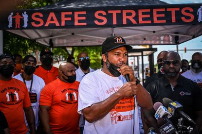 Safe Streets Belair-Edison site director Dante Johnson speaks Tuesday at the launch event for the Safe Summer 2021 initiative. The announcement comes as Baltimore battles crippling violence, leaders grasp for solutions and the Safe Streets organization's 10 facilities across the city show signs they are making a difference.