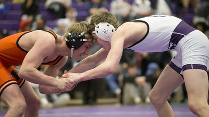McDonogh's Ray Kable, left. wrestles Mount Saint Joseph's Connor Strong, right, in a 132-pound match during the MIAA wrestling championships finals Saturday, Feb. 10, 2018.