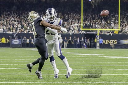 Rams cornerback Nickell Robey-Coleman seems to deliver an early hit to New Orleans Saints receiver Tommylee Lewis late in the fourth quarter, thwarting a potential game-winning drive in the NFC Championship at the Superdome.