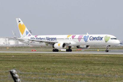 """Condor Airlines' German slogan is """"Wir lieben Fliegen"""" [""""We love to fly""""]."""