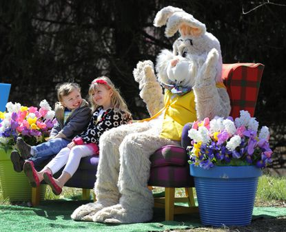 Logan Snyder, 3 and his sister, Kaitlyn Snyder, 6, of Forest Hill have their picture taken with the Easter Bunny at Bunny BonanZOO at the Maryland Zoo. The event ran March 29-31.