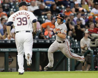 Steve Pearce of the Orioles scores in the fifth inning on a triple by Ryan Flaherty against the Houston Astros at Minute Maid Park on June 1, 2015 in Houston.