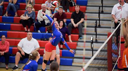 Centennial outside hitter Jackie Sterenberg goes up for a kill during a 3A East region playoff volleyball match against visiting Reservoir on Monday, November 6, 2017.