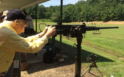 "World War II veteran George Anderson, 94, of Hope, N.J., fires an M2 Browning .50-caliber machine gun at a firing range in Marriottsville last year. A proposed high-end ""guntry club"" recently won zoning approval in Owings Mills."