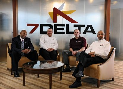 Executive staff of 7Delta (from left) Jonathan Studdard, principal, Jay Costenbader, vice president, E. Todd Leap, COO., and Michael C. Sawyers, president and CEO, at the company's Columbia headquarters. 7Delta, a fast-growing IT firm, is among the many smaller federal contractors that are looking to do business with more federal agencies.