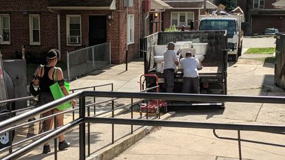Crews work to replace toilets at the Poe Homes public housing complex in Baltimore.