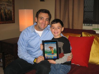 Meteorologist Justin Berk and his son, Brendan, 6, show off the weather app for kids they developed.