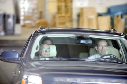 John Paterakis (left) is driven from the garage of the Mitchell Courthouse in Baltimore after pleading guilty to two campaign finance violations, both misdemeanors.