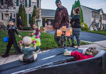 It's a bit spooky for Trick or Treat in Sykesville as Jayden and Gabriella Ferrara walk past an open casket display at Mike Marbut's home during Halloween 2018. Trucker and Rachael Ferrara stroll with their children through a collection spooky scenes.