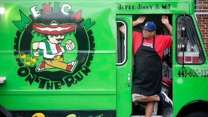 Mexican On The Run food truck's Jimmy Longoria stands in the door of his truck at Food Truck Wednesday at the Arbutus Volunteer Fire Department in Arbutus on Wednesday, June 7, 2017.