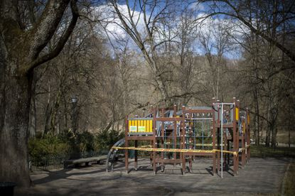 An empty children's playground after the government banned its usage due to the outbreak of the coronavirus, in Vilnius, Lithuania, Tuesday, March 31, 2020. All public and private events are banned in Lithuania, clubs, bars restaurants and most shops are closed due to the virus outbreak. (AP Photo/Mindaugas Kulbis)