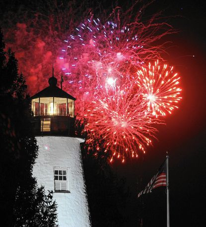 Fireworks light up the sky behind the Concord Point Lighthouse during last year's War of 1812 tourism success. This year, the city is promoting itself on Orioles telecasts on MASN.