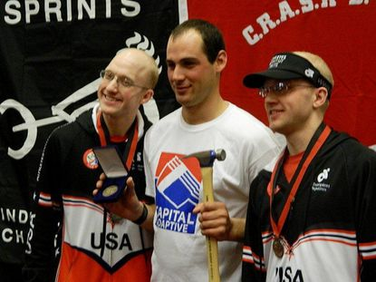 Carroll County Special Olympic athlete Syd Lea, center, of Taneytown, won the World Indoor Rowing Championships held in Boston last month in the adaptive athlete intellectual disability division, breaking the world record he had set two weeks earlier, in 3:10.7 for the 1,000-meter event. Bruce Worley, right, and Mark Worley, of Howard County placed second and third respectively.