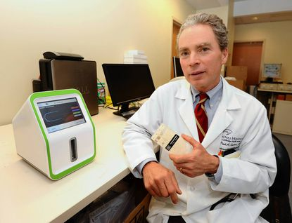 At Sinai hospital, Dr. Paul A. Gurbel, conducts research on medications that prevent blood clots that may cause a heart attack.