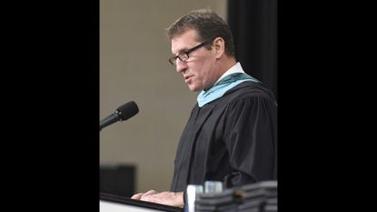 Principal Troy Barnes speaks during Century High School's graduation ceremony on June 5, 2018 at McDaniel College in Westminster. Barnes is the choice to be Carroll County Public Schools' first director of advanced academics.