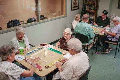 Two tables of mahjong players are engaged on a recent Wednesday at the Arbutus Senior Center.